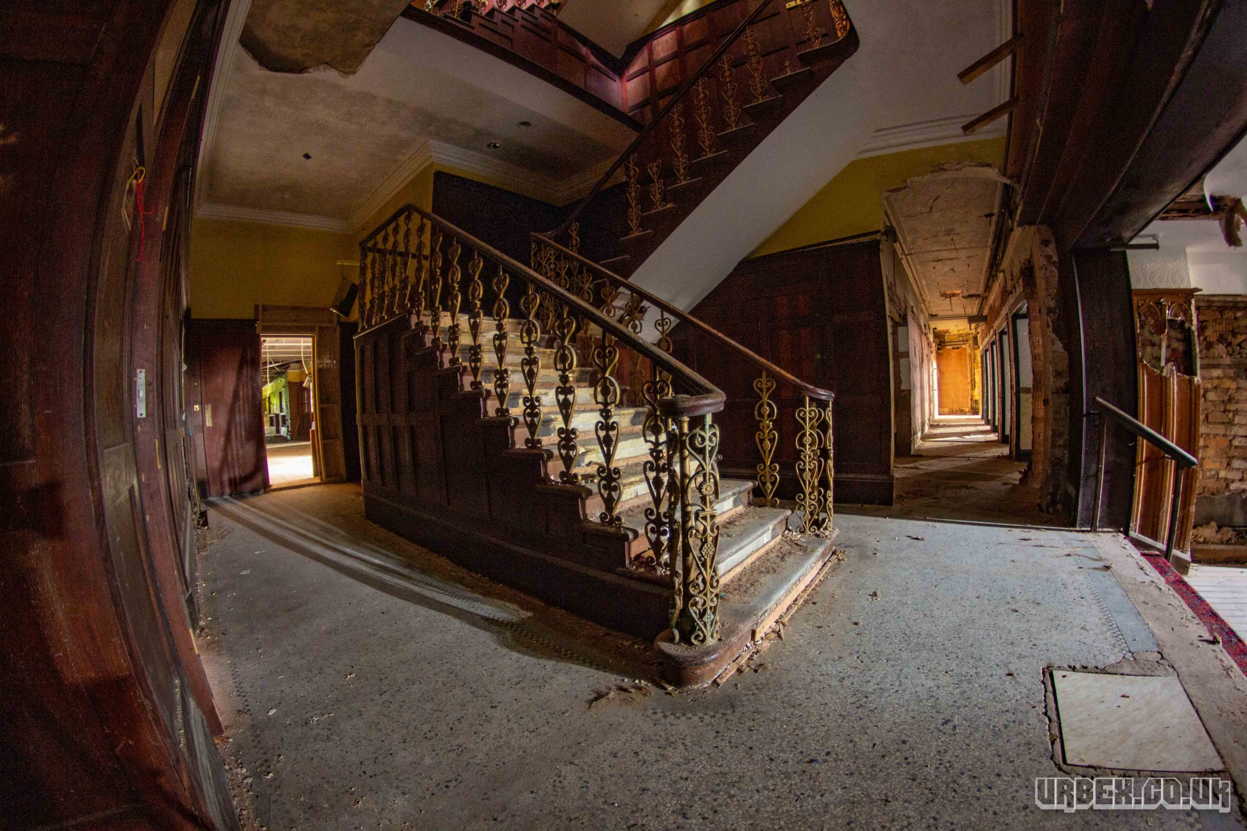 Grand stair case in the reception of an abandoned hotel