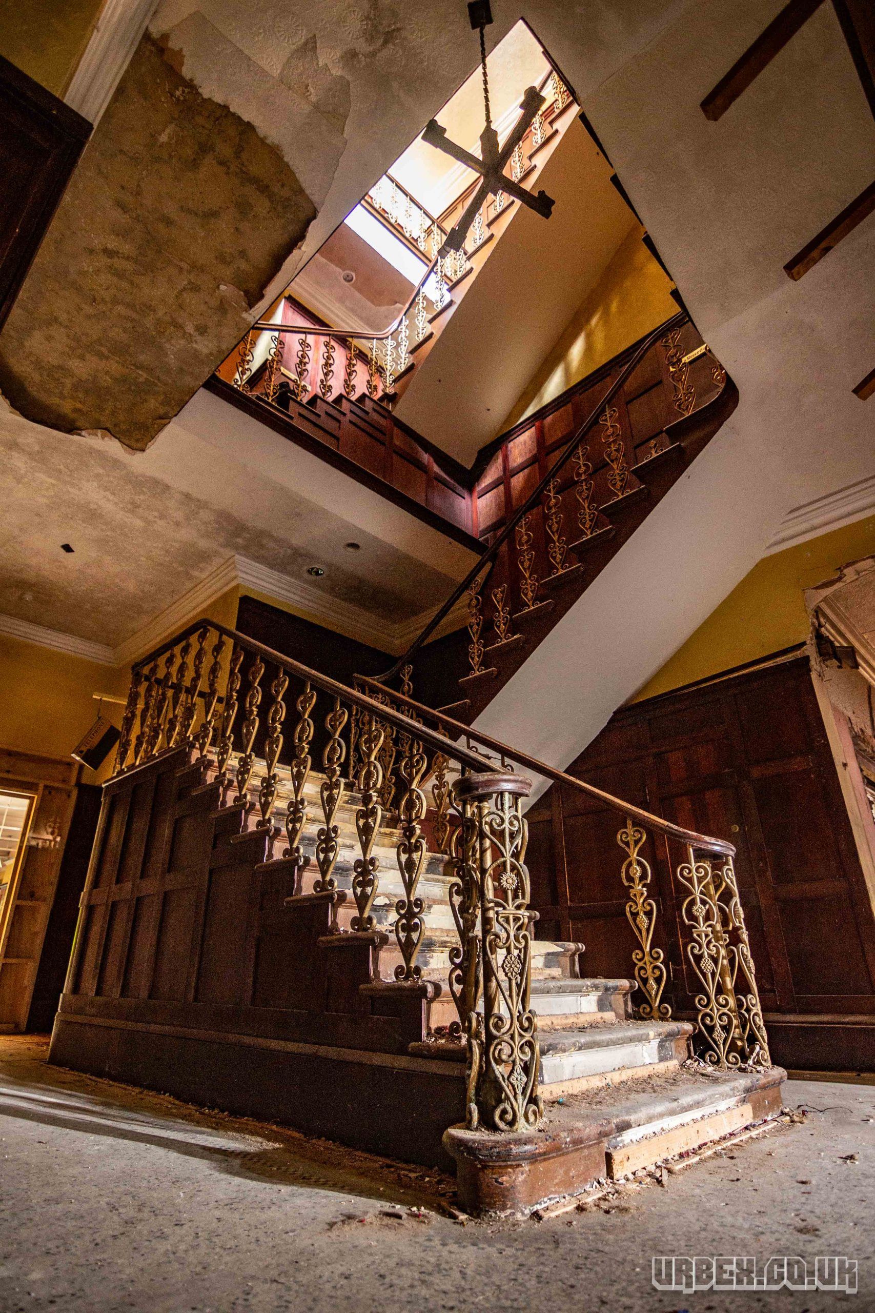 3 story stair case in a derelict hotel